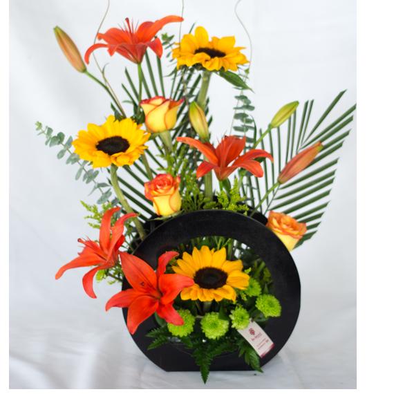 arreglos florales con girasoles y lirios en quito